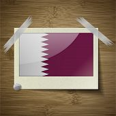 foto of qatar  - Flags of Qatar at frame on wooden texture - JPG