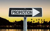 stock photo of promoter  - Promotion direction sign with sunset background - JPG