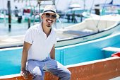 foto of casual wear  - Young man at the beach wearing casual clothing - JPG