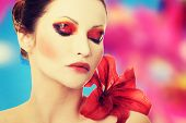 picture of lillies  - Young woman with red lilly flower - JPG