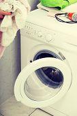 image of washing-machine  - Woman do washing in a washing machine - JPG