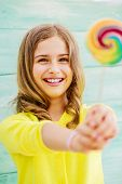 picture of lollipops  - Cheerful young girl with a lollipop - JPG