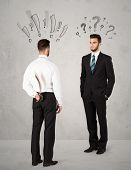 foto of backstabbers  - Ruthless businessman handshake with drawn exclamation and question marks around them head - JPG