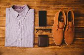 picture of loafers  - Shirt shoes glasses next to wallet and smartphone on wooden table - JPG