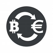 picture of bitcoin  - Image of exchange between bitcoin and euro in black circle - JPG