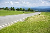 stock photo of bavaria  - An image of a winding road at the Hoher Peissenberg Bavaria Germany - JPG