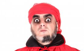 image of sorcerer  - Hypnotist or sorcerer is doing hypnosis or magic with scary spooky eyes - JPG