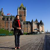 Tourist on Terrasse Dufferin in front of Chateau Frontenac - The most famous landmark in Quebec City.
