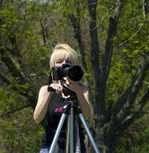 Cute Blond Photographer poster