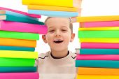 Boy Behind Pile Of Books