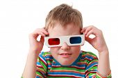 little concentrated boy in striped shirt and anaglyph glasses, red and blue