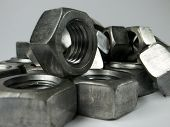 foto of m16  - M16 metric bright silver nuts on a neutral background - JPG