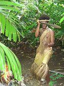 Melanesian In Native Traditional Dress Threatening With Spear. Vanuatu.