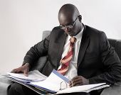 African businessman folding a copybook