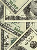 US banknotes in hundred dollar bills background