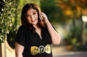 picture of plus size model  - Beautiful plus size model outdoors - JPG
