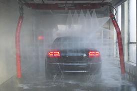 foto of car wash  - Black sedan getting clean - JPG