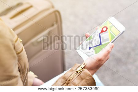 poster of Tourist Using Map In Phone App To Navigate And Find Location Of Hotel In City. Woman With Smartphone