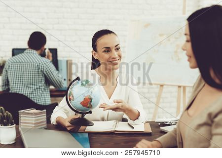 Young Woman In Travel Agency