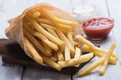 French fries, deep fried potato chips with ketchup and mayonnaise poster