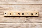 Kindness Word Written On Wood Block. Kindness Text On Table, Concept. poster