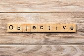 Objective Word Written On Wood Block. Objective Text On Table, Concept. poster