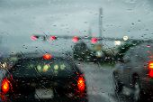 Wet windshield and blurred traffic during rain storm