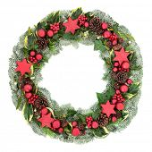Christmas wreath with red bauble decorations, winter flora of holly, mistletoe, ivy, snow covered sp poster