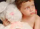 Cute young boy hugging big stuffed bunny