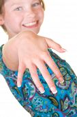young girl happy to show off press-on nails