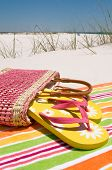 Beach sandals at seashore on towel