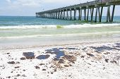 PENSACOLA BEACH - JUNE 23:  Oil covered sand is shown near the pier area on June 23, 2010 in Pensacola Beach, FL.