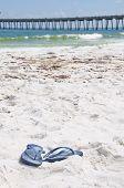 PENSACOLA BEACH - JUNE 23: A deserted pair of flip flops lie on the beach on June 23, 2010 in Pensacola Beach, FL