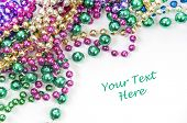 pic of mardi gras mask  - holiday or mardi gras beads - JPG
