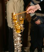 Rabi lights a candle in the Jewish holiday of Hanukkah