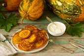 Homemade Pumpkin Pancakes With Sour Cream, Ripe Pumpkin And Pumpkin Leaves. poster