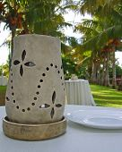Clay Lantern On Table In Tropical Setting