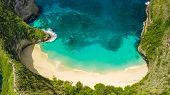 Aerial panorama over the Kelingking beach and coastline in Nusa Penida island, Bali, Indonesia poster