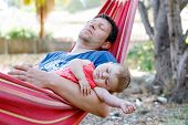 Cute Adorable Baby Girl Of 6 Months And Her Father Sleeping Peaceful In Hammock In Outdoor Garden. C poster