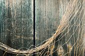 Fishing Nets Over Wooden Background With Copy Space. Fishing Nets On Wooden Background. Hanging Fish poster
