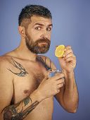 Hipster Drink Clean Healthy Water With Lemon, Refreshing. Man With Long Beard Hold Water Glass On Bl poster