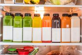 Juicing cold pressed vegetable juices for a detox cleanse diet. Dieting bydrinking organic fruits an poster