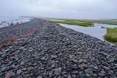 Dramatic Beach Of Black Pebbles In Iceland poster