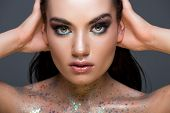 Glamorous Woman With Makeup And Glitter On Body, Isolated On Grey poster