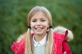 Child Blonde Long Hair In Warm Jacket Nature Background. Girl Charming Smile Coat Enjoy Fall Park. C poster