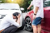 Two Men Arguing After A Car Accident Traffic Collision On The Road. poster