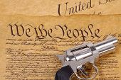 picture of preamble  - declaration of independence and a gun - JPG