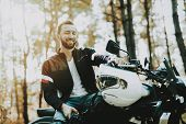 Motorcycle Biker Stops On Highway In A Forest. Speed Vehicle. Cool Rider With A Leather Jacket. Moto poster