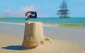 foto of pirate ship  - Pirate Sand Castle with Pirate Ship in Distance - JPG