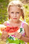 Cute Girl With Pigtails Eating A Watermelon